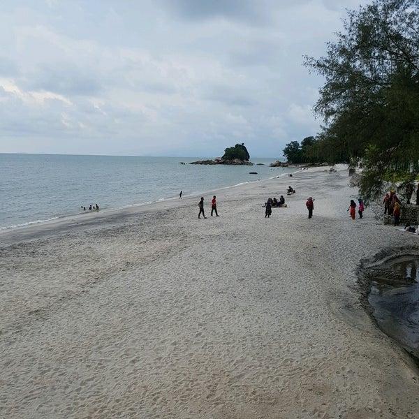 Photo taken at Teluk Bahang Beach by Ariff A. on 4/24/2017