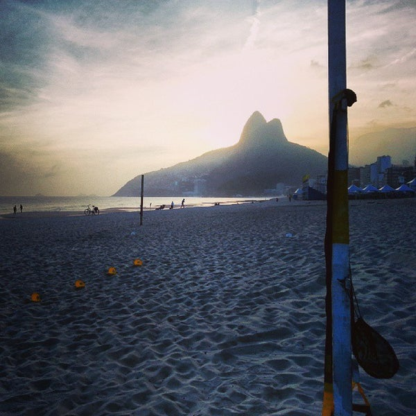 Photo taken at Ipanema Beach by Marcello B. on 10/23/2013