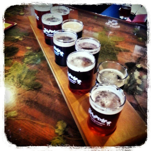 Photo taken at Strange Craft Beer Company by Heather B. on 3/31/2013