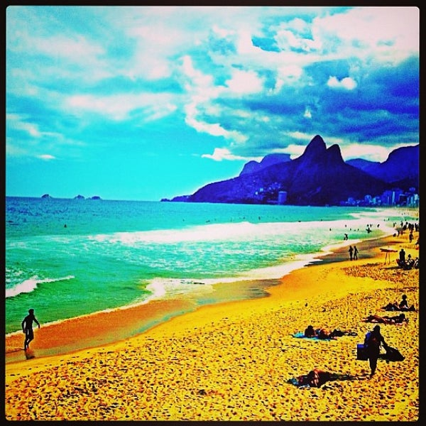 Photo taken at Ipanema Beach by Bianca R. on 6/4/2013