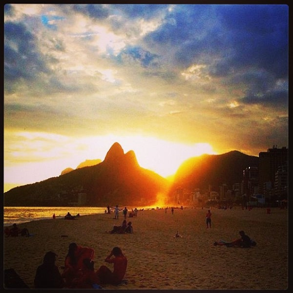 Photo taken at Ipanema Beach by Bianca R. on 6/1/2013