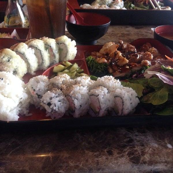 Photo taken at Sushi Tomo by Sarah V. on 12/30/2014