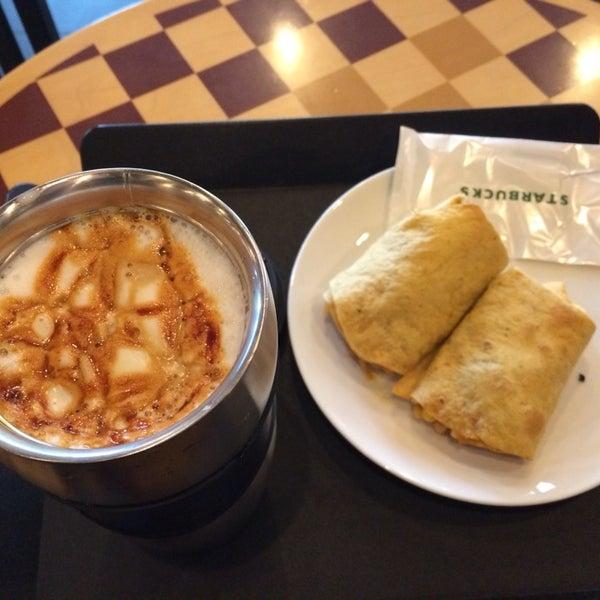 Photo taken at Starbucks by elf r. on 3/11/2014
