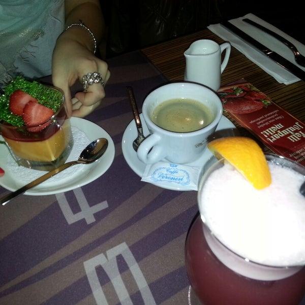 Photo taken at Zebra Café by Karla T. on 12/21/2013