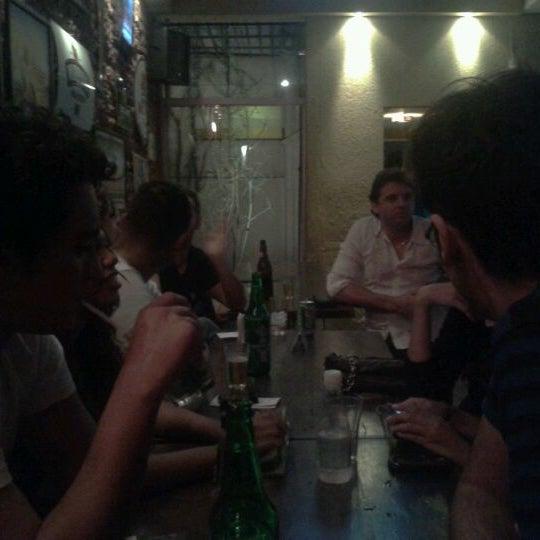 Photo taken at Mundaka Adventure Bar by Caio A. on 3/31/2012