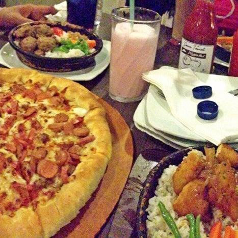 Photo taken at Pizza Hut by Kasih B. on 7/22/2014