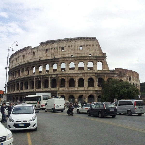 Photo taken at Piazza del Colosseo by Raymond W. on 6/4/2013