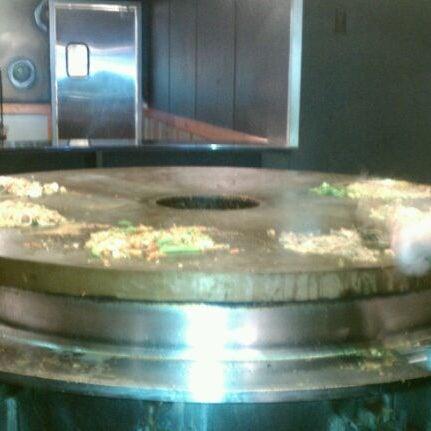 Photo taken at HuHot Mongolian Grill by KDIVA on 2/10/2012