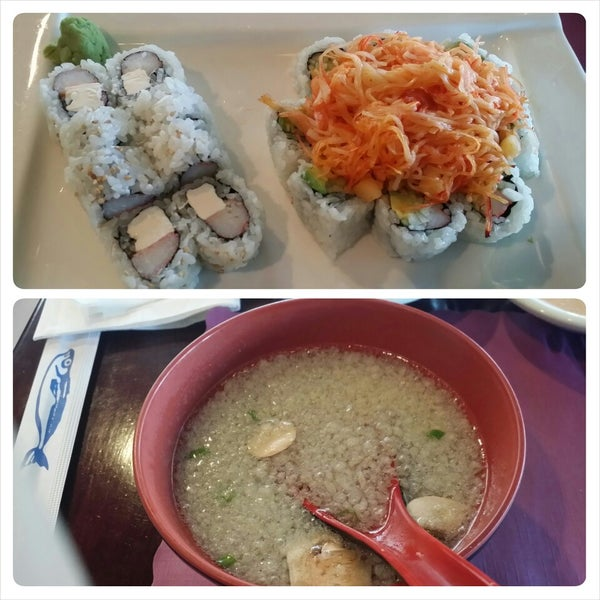 Photo taken at Sushi Cafe by Andrea J. on 3/26/2014
