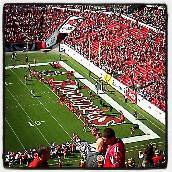 Photo taken at Raymond James Stadium by Erin W. on 11/25/2012