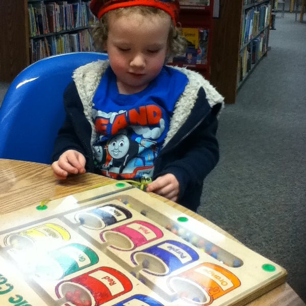 Photo taken at Indianapolis Marion County Public Library - Southport Branch by Emily A. on 3/17/2013