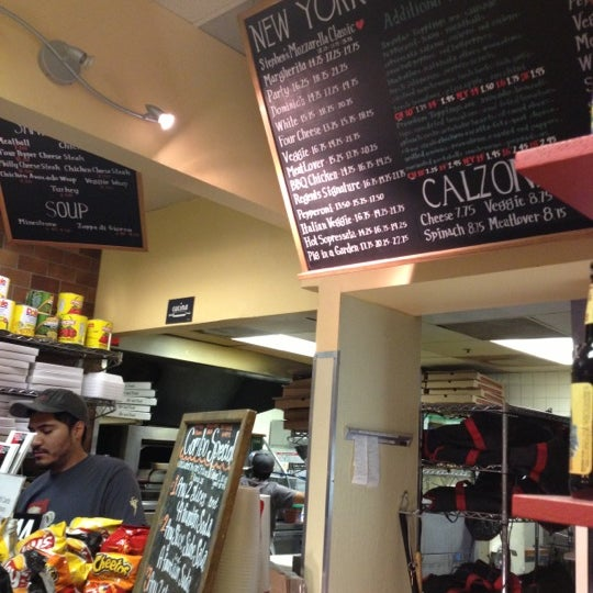 Photo taken at Regents Pizzeria by Rachel S. on 12/23/2012