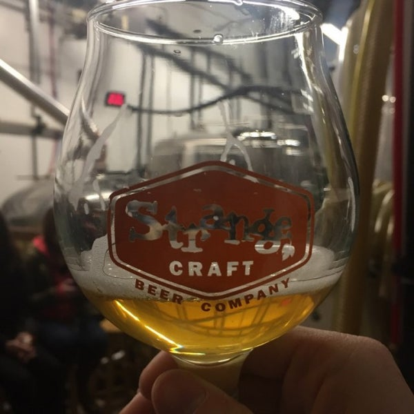 Photo taken at Strange Craft Beer Company by Forrest S. on 11/26/2016