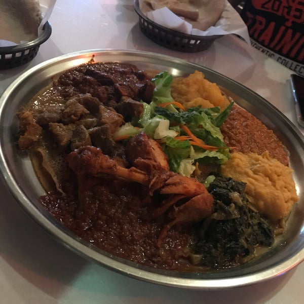 Photo taken at New Eritrea Restaurant & Bar by Melissa D. on 7/25/2017