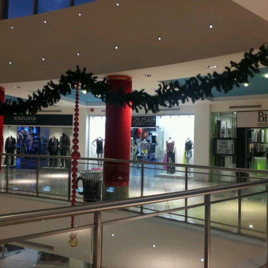 Photo taken at Trincity Mall by Dwight N. on 1/9/2013