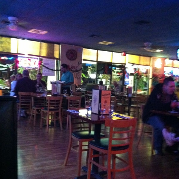 Photo taken at Amigos Mexican & Spanish Restaurant by Jerome B. on 12/21/2012