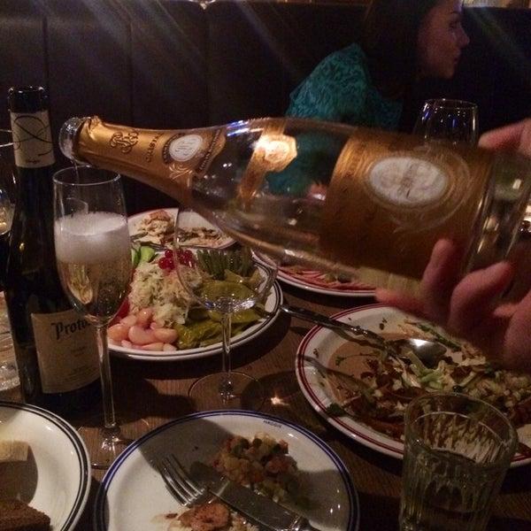 Photo taken at Haggis Pub & Kitchen by Ekaterina B. on 12/26/2014