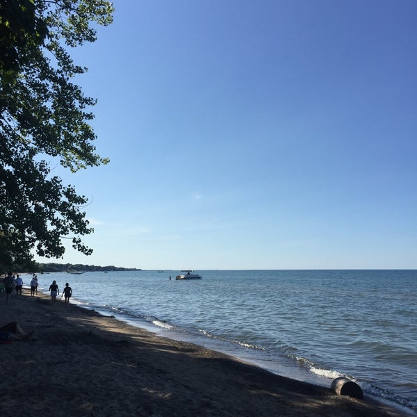 Photo taken at Durand Eastman Beach by Katie B. on 8/8/2016