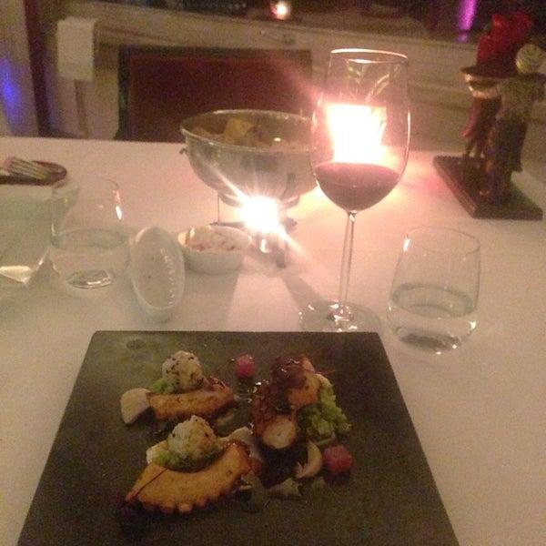 Photo taken at Imago Restaurant by Olga on 3/11/2014