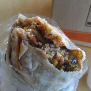 Photo taken at Bandit Burrito by Ben T. on 5/4/2012