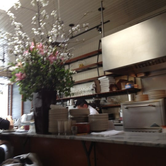 Photo taken at Universal Cafe by David H. on 3/16/2012