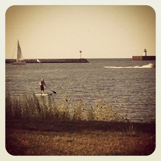 Photo taken at Whiskey Island Volleyball Courts by Emma B. on 8/7/2012