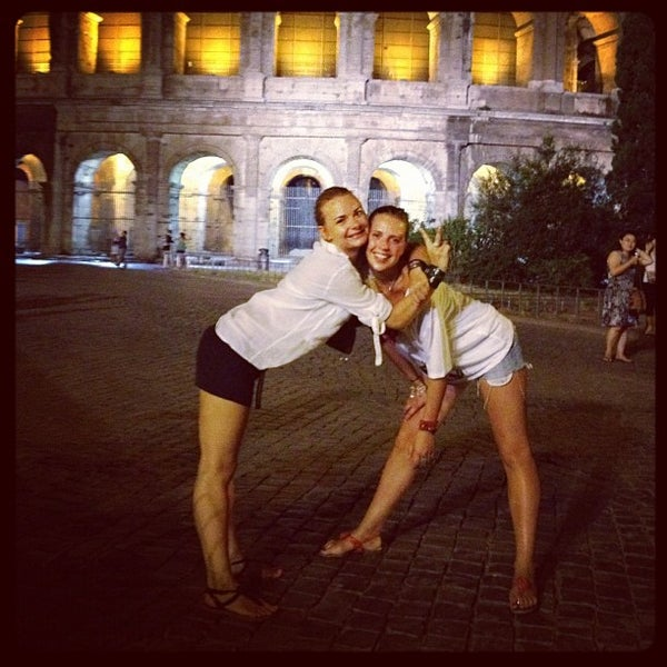 Photo taken at Piazza del Colosseo by Olya K. on 7/10/2012