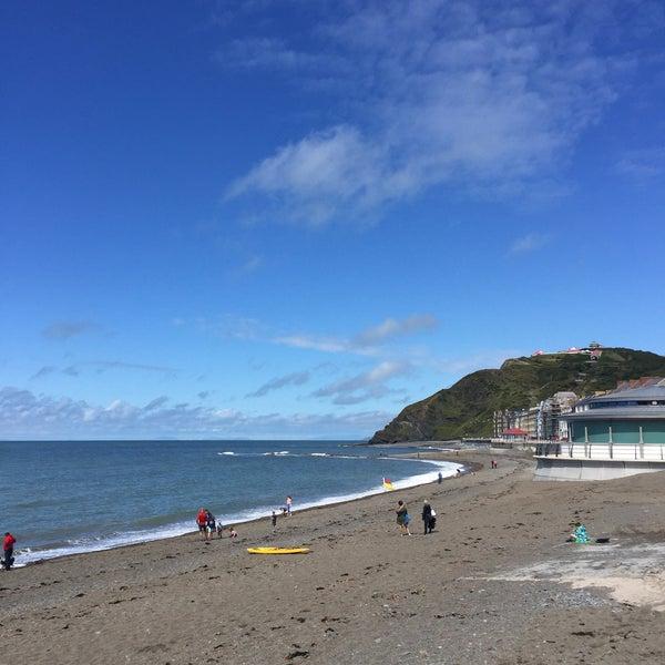 Photo taken at Aberystwyth Beach by Angela H. on 8/1/2017