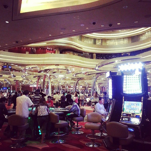 Photo taken at Marina Bay Sands Casino by Eugene M. on 8/4/2013