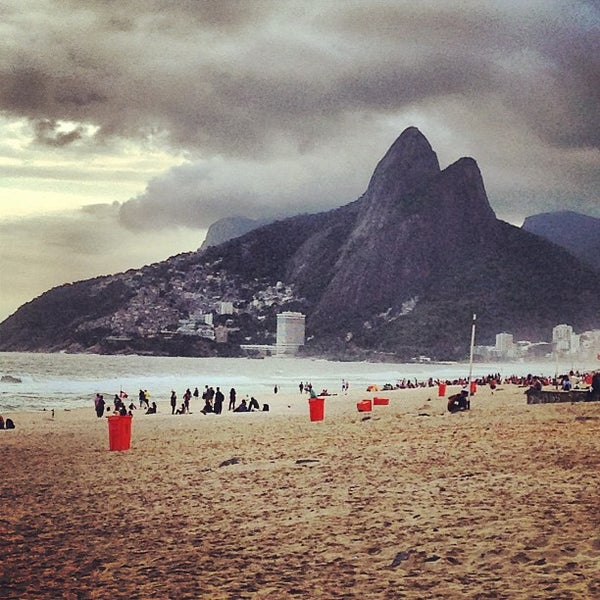 Photo taken at Ipanema Beach by Chris H. on 5/19/2013