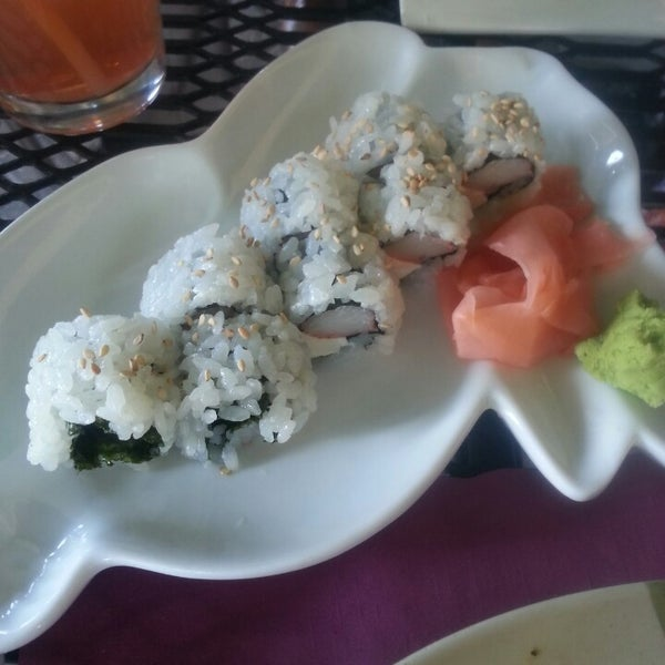 Photo taken at Sushi Cafe by Janaé N. on 3/9/2014