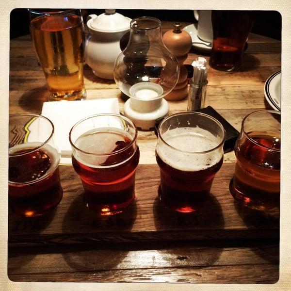 Photo taken at Haggis Pub & Kitchen by Anton C. on 8/30/2014
