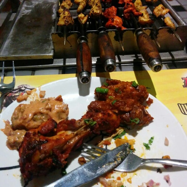 Photo taken at Absolute Barbecues (ABs) by Syed R. on 4/17/2014