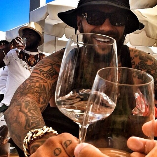 Photo taken at Club Les Palmiers by TIMATI on 8/18/2014