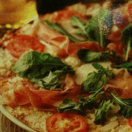 Photo taken at California Pizza Kitchen by Neil R. on 10/20/2012