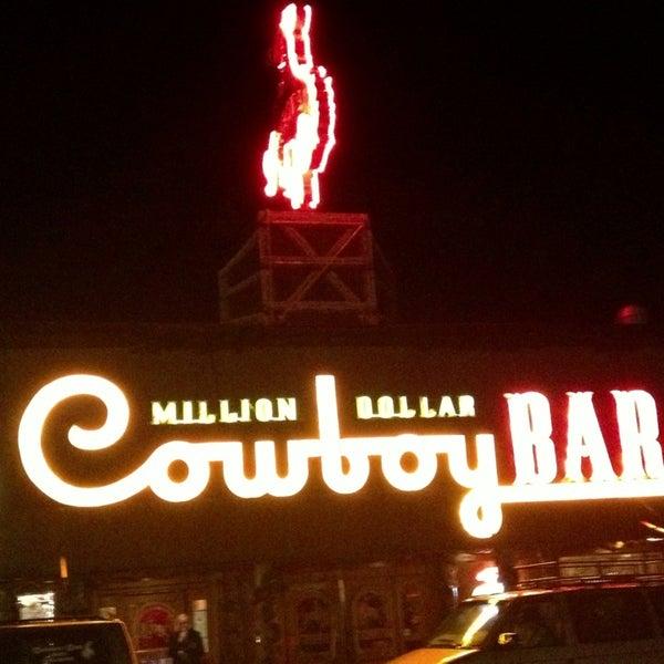 Photo taken at Million Dollar Cowboy Bar by Josh A. on 3/30/2013
