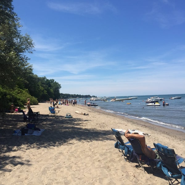 Photo taken at Durand Eastman Beach by Sean T. on 8/2/2015