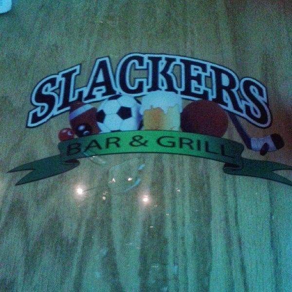 Photo taken at Slackers Bar & Grill by Natasha F. on 12/24/2014