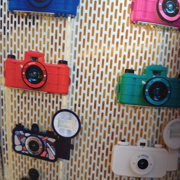 Photo taken at Lomography Gallery Store by Dayana O. on 10/12/2013