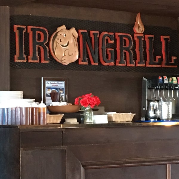 Photo taken at Iron Grill Barbecue and Brew by Cari T. on 1/1/2018