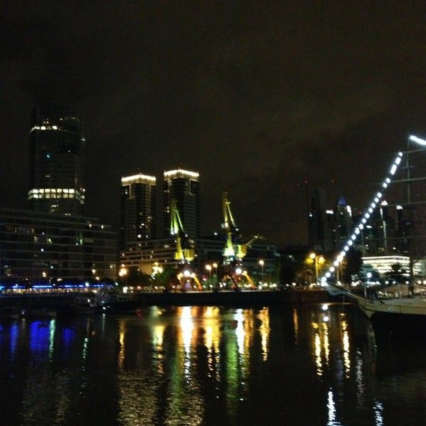 Photo taken at Puerto Madero by Carolina A. on 1/5/2013