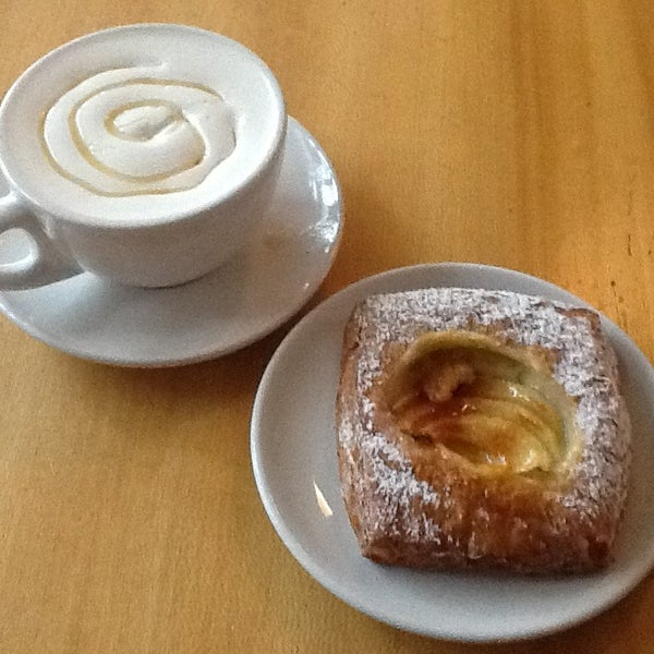 Photo taken at Victrola Cafe and Roastery by Rebecca N. on 1/27/2013