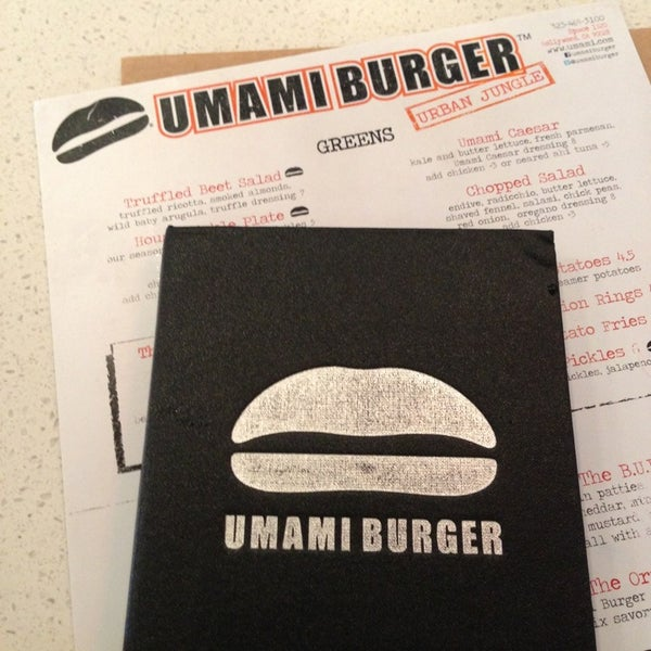 Photo taken at Umami Burger by Ari R. on 7/2/2013