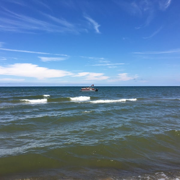 Photo taken at Durand Eastman Beach by Tim P. on 7/16/2016