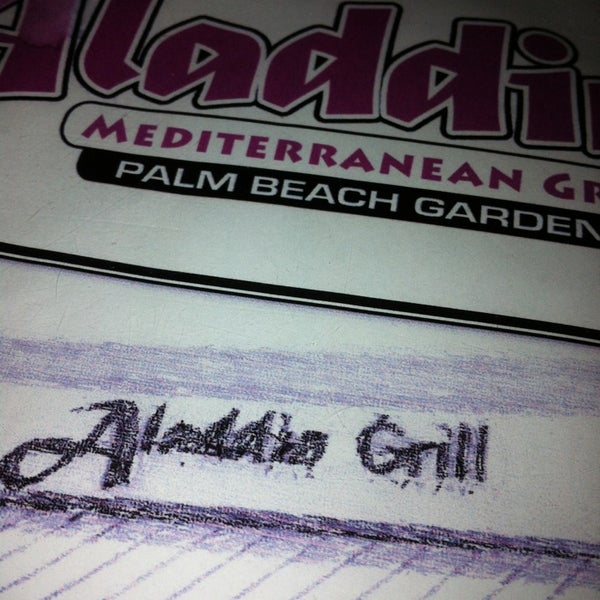 Photo taken at Aladdin Mediterranean Grill by André D. on 4/9/2013