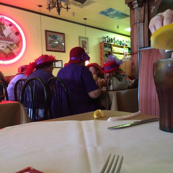 Photo taken at Aladdin Mediterranean Grill by André D. on 5/10/2014