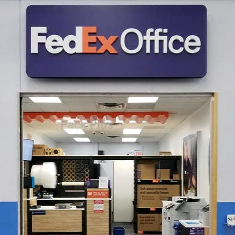 photo taken at fedex office print ship center inside walmart by yext