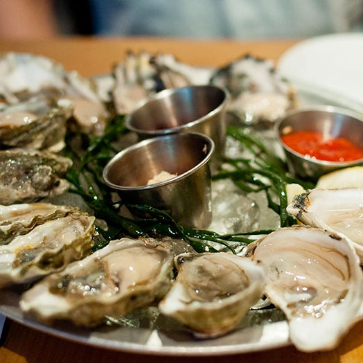 Every day from 5 to 7 p.m., you can get half a dozen oysters and a craft beer for $12 at this tiny East Village seafood joint. (And if you're nice, they'll even give you a free slice of whiskey cake.)