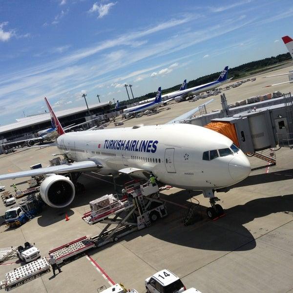 Photo taken at Narita International Airport (NRT) by Isao y. on 7/19/2013