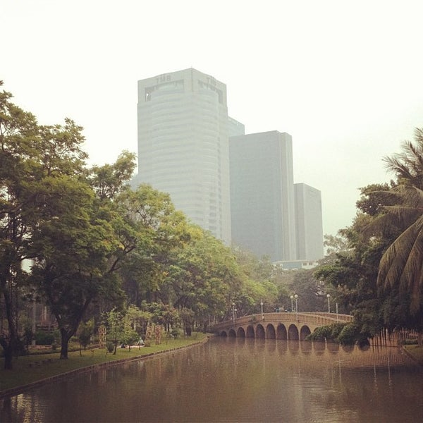 Photo taken at Queen Sirikit Park by Winnie S. on 1/11/2013